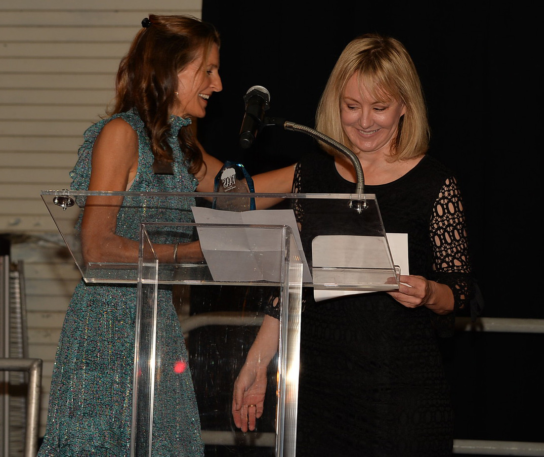 Shelly receiving award